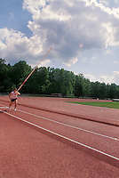 Champion pole vaulter in preperation.