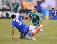 Mexico Javier Hernadez (14) gets fould by Guatemala Cristian Noriega (3) Mexico defeated Guatemala 2-1 in the quaterfinals for the 2011 CONCACAF Gold Cup , at the New Meadowlands Stadium, Saturday June 18, 2011.