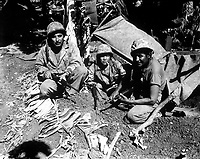 Navajo Indian communication men with the Marines on Saipan landed with the first assault waves to hit the beach. Ca. June 1944. J. L. Burns (Marine Corps)<br /> Exact Date Shot Unknown<br /> NARA FILE #:  127-N-82619<br /> WAR &amp; CONFLICT BOOK #:  1193