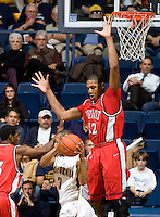 11 November 2009:  Eli Holman of Detroit tries to block California's Jerome Randle's shot during the game at Haas Pavilion in Berkeley, California.   California defeated Detroit, 95-61.
