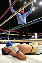 Jorge Solis (MEX),..DECEMBER 31, 2011 - Boxing :..The referee stops the fight as Jorge Solis of Mexico lies on the ring after being knocked out in the eleventh round during the WBA super featherweight title bout at Yokohama Cultural Gymnasium in Kanagawa, Japan. (Photo by Hiroaki Yamaguchi/AFLO)