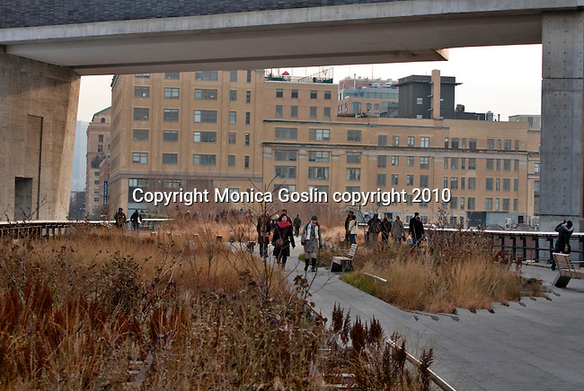 The Standard Hotel in New York City with the Highline, an elevated public park on and old railway line, passing under the hotel. People walking on the Highline under The Standard Hotel on a winter day in New York City