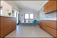 BNPS.co.uk (01202 558833)<br /> Pic: Jackson-Stops/BNPS<br /> <br /> ****Must use full byline****<br /> <br /> The open-plan kitchen and dining room.<br /> <br /> A stunning cliff-top house has grown into a 1.25 million pounds property after it was built on a disused allotment.<br /> <br /> Jamie and Zoe McLintock forked out &pound;80,000 for the overgrown plot of land eleven years ago because it was atop a cliff along Devon's craggy coastline.<br /> <br /> The enterprising couple spent a further &pound;600,000 and three years of their time building the beautiful five-bedroom pad.<br /> <br /> But they are now set to double their money after the incredible property went on the market for a whopping &pound;1.25 million with estate agents Jackson-Stops.<br /> <br /> The white-washed three-storey house is perched on top of 100ft cliffs overlooking Tunnels Beaches in Ilfracombe, a stretch of private Victorian beach owned by the couple since 2001.