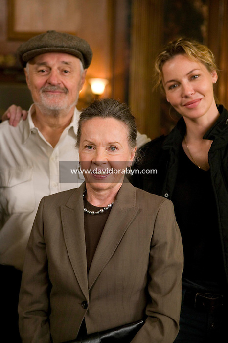 "8 May 2006 - North Bergen, NJ - French actress Leslie Caron (C) poses with Director Ted Kotcheff (L) and Connie Nielsen on the studio set of television show ""Law & Order: SVU"" in North Bergen, USA, 8 May 2006. In this rare appearance in front of American television cameras, Caron, 74, plays a French victim of past sexual molestation in an episode entitled ""Recall"" due to air in the fall. Caron starred in Hollywood classics such as ""An American in Paris"" (1951), ""Lili"" (1953), ""Gigi"" (1958). More recently she appeared in ""Chocolat"" (2000) and ""Le Divorce"" (2003)."