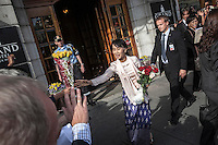 Burmese pro-democracy leader AUNG SAN SUU KYI leaves the Grand Hotel in Oslo to attends a meeting with the Prime Minister Stoltenberg as she helds her first official diplomatic visit away from her country after 15 years of home arrest. She visits Switzerland, Norway, Ireland, Britain and France from June 13 to June 29 2012.
