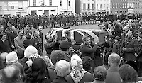 The union jack draped coffin of Cormac McCabe, a UDR Captain,  who was kidnapped and murdered by the Provisional IRA, is carried into the local church in his home town of Aughnacloy, Co Tyrone on 22nd January 1974. Mr McCabe's body was found a short distance inside N Ireland on the Tyrone-Monaghan border near Clogher. Mr McCabe, from Aughnacloy, was the headmaster of a local school and a close friend of Ulster Unionist Westminister MP, Ken Maginnis. Mr McCabe was kidnapped by the Provisional IRA from a hotel in Monaghan town where he was having lunch with his wife and family. Mr McCabe was kidnapped on Saturday, 19th January 1971, his body was recovered on Sunday 20th January and his funeral was on 22nd January 1974. 197401200026c..Copyright Image from Victor Patterson, 54 Dorchester Park, Belfast, United Kingdom, UK.  Tel: +44 28 90661296; Mobile: +44 7802 353836; Voicemail: +44 20 88167153;  Email1: victorpatterson@me.com; Email2: victor@victorpatterson.com..For my Terms and Conditions of Use go to http://www.victorpatterson.com/Terms_%26_Conditions.html