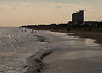 Though the beach is nearly deserted in winter, there are usually a few people walking even in the dead of winter.  Rehoboth Beach, Delaware, USA.