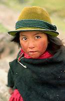 July 1995, Ecuador --- A little Ecuadorian girl wears a green hat and poncho to protect against the cold. --- Image by &copy; Owen Franken/CORBIS