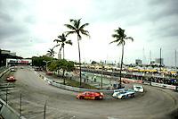 MIAMI, FL - FEBRUARY 26: The #30 MOMO Corse Alba/Momo AR3 001/Ford of Gianpiero Moretti and Oscar Larrauri exits the hairpin turn during the Budweiser Grand Prix of Miami IMSA GTP race on the temporary street circuit in Bicentennial Park in Miami, Florida, on February 26, 1984.