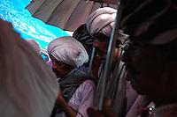 Maldhari men watching a wedding ceremony..Michael Benanav - mbenanav@gmail.com