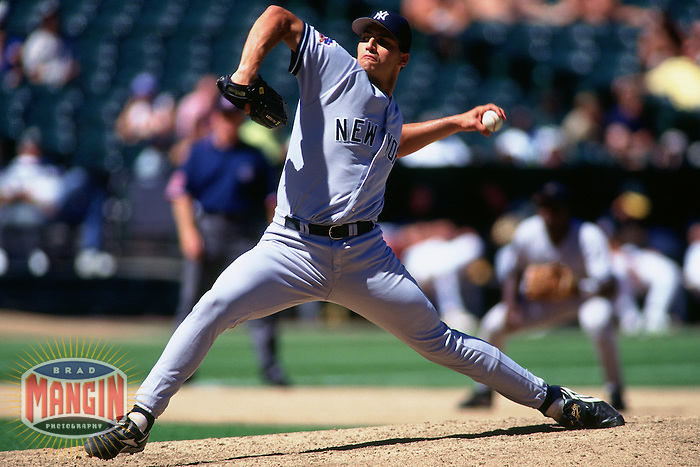 OAKLAND, CA - Andy Pettitte of the New York Yankees pitches against the Oakland Athletics at the Oakland Coliseum in Oakland, California on August 26, 1997. Photo by Brad Mangin