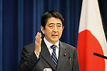 Shinzo Abe, prime minister of Japan, poses for photographers before a news conference at the prime minister's office in Tokyo in July, 2007.   .Photographer: Rob Gilhooly
