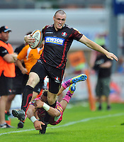 Shane Monahan is tackled in possession. J.P. Morgan Premiership Rugby 7s match, between Exeter Chiefs and Gloucester Rugby on July 27, 2012 at Kingsholm Stadium in Gloucester, England. Photo by: Patrick Khachfe / Onside Images
