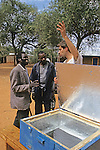 Dan Kammen Explaining How Solar Oven Works To Locals