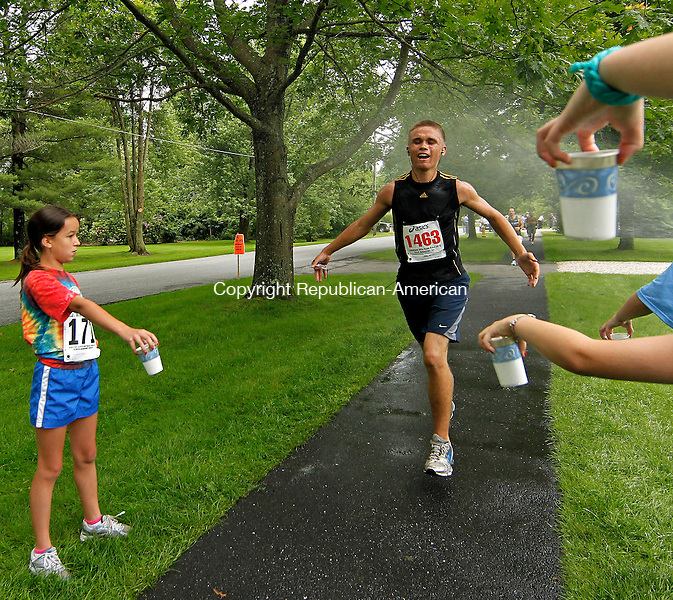 Litchfield, CT-13, June 2010-061310CM03   Gunner Hoffman, of Bethlehem enters through the final water station during 34th annual Litchfield Hills Road Race. Julius Kiptoo, of Kenya, was the first to finish, winning with a time of 34:58.  --Christopher Massa Republican-American