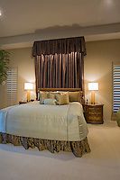 Modern Master bedroom with dramatic headboard canopy