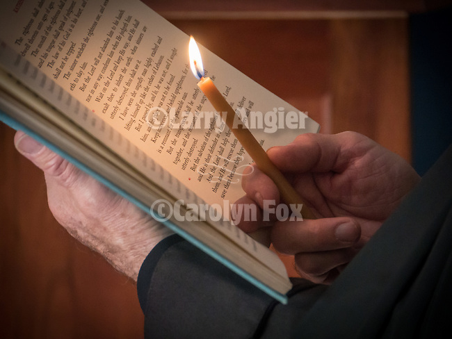 Reading by candle from the holy scriptures during the First Monastic Liturgy, St. Silhouan Monastery, Columbia, California.