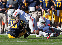Ohio State Buckeyes cornerback Bradley Roby (1) makes a tackle on California Golden Bears wide receiver Darius Powe (10) in the 1st quarter at Memorial Stadium in Berkeley, California on September 14, 2013.  (Dispatch photo by Kyle Robertson)