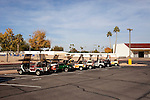Golf carts, a common mode of transportation in Sun City, Arizona, sit parked in a line outside of the Bell Recreation Center December 10, 2010. Many of the busy roads offer a golf cart lane...2010 marks the 50th anniversary of Sun City, America's first retirement city that remains the largest today with more than 40,000 residents 55 and older.