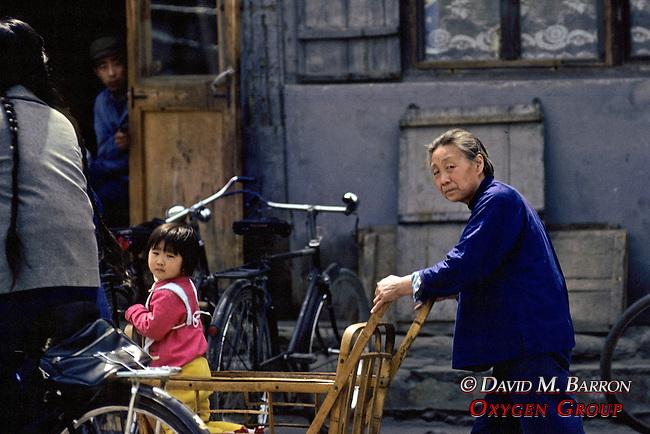 Older Woman Pushing Girl In Cart