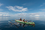 West Papuan fisherman in his outriggered boat