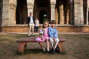 Managing Editor of FT, James Lamont poses with his wife, Claire Lamont and their two children - Isobel Lamont (4) and Oliver Lamont (8) in Lodi Gardens in New Delhi, India. Photo: Sanjit Das/Panos