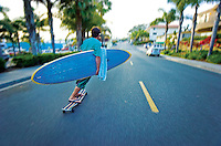 John Stein longboarding to the beach