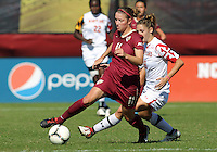 COLLEGE PARK, MD - OCTOBER 21, 2012:  Becky Kaplan (19) of the University of Maryland comes up behind Isabella Schmid (11) of Florida State during an ACC women's match at Ludwig Field in College Park, MD. on October 21. Florida won 1-0.