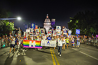AUSTIN, TEXAS - Members of the Travis County Democratic Party holding Hillary Clinton signs for president, walk in the Austin PRIDE 2016, the annual gay pride parade, as it makes its way through downtown Saturday, Aug. 27, 2016. <br /> <br /> Use of this image in advertising or for promotional purposes is prohibited.<br /> <br /> Editorial Credit: Dan Herron / Herronstock Editorial.