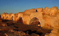 """Low angle view of arches of the Roman Acqueduct of Zaghouan, Carthage, Tunisia, pictured on January 30, 2008, in the morning. Carthage was founded in 814 BC by the Phoenicians who fought three Punic Wars against the Romans over this immensely important Mediterranean harbour. The Romans finally conquered the city in 146 BC. Subsequently it was conquered by the Vandals and the Byzantine Empire. Today it is a UNESCO World Heritage. The aqueduct was built in the 2nd century AD, during the reign of the emperor Hadrian and supplied the nearby cisterns (""""Citernes de la Malga""""). Picture by Manuel Cohen."""