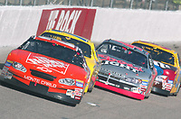 Tony Stewart leads a pack of cars down the front straightaway during the Pop Secret 400 NASCAR Winston Cup race at Rockingham, NC on Sunday, November 9, 2003. (Photo by Brian Cleary)