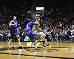 "Ole Miss' Marshall Hendserson (22) shoots against Lipscomb's Deonte Alexander (4) and Lipscomb's John Ross Glover (14) at the CM. ""Tad"" Smith Coliseum in Oxford, Miss. on Friday, November 23, 2012."