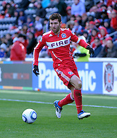 Chicago Fire midfielder Gonzalo Segares (13) looks to cross the ball.  The Chicago Fire defeated Sporting KC 3-2 at Toyota Park in Bridgeview, IL on March 27, 2011.