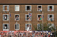 A room with a view as locals celebrate England's Ashes victory in London, England, on Sunday, August 23, 2009. Photo Tim Clayton.