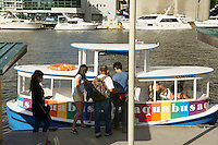 People boarding the aquabus water taxi, Granville Island, Vancouver, British Columbia, Canada