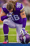 19 October 2014: Minnesota Vikings defensive end Brian Robison makes a pre-game prayer prior to facing the Buffalo Bills at Ralph Wilson Stadium in Orchard Park, NY. The Bills defeated the Vikings 17-16 in a dramatic, last minute, comeback touchdown drive. Mandatory Credit: Ed Wolfstein Photo *** RAW (NEF) Image File Available ***