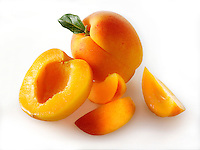Fresh apricots whole and cut in halves