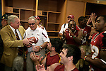 Florida State University president T.K. Wetherell (L) presents the game ball to head coach Bobby Bowden in recognition of his 500th collegiate football game in the dressing room after the Seminoles defeated the Colorado Buffaloes 39-21 in Jacksonville, Florida September 27, 2008.  Florida State defeated Colorado 39-21.   (Mark Wallheiser/TallahasseeStock.com)