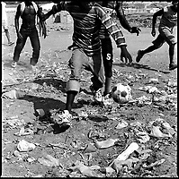 Luanda, Angola, May, 25, 2006..Porto do Pesqueiros, open air sewer; children playing football in garbage. Between February and June 2006, more than 30000 people were infected with cholera in Angola's worse outbreak ever; more than 1300 died.