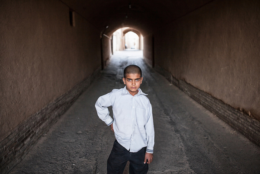 An Iranian boy at Yazd Old City. Yazd is one of the oldest living city in the world. Yazd was visited by Marco Polo in 1272, who described it as a good and noble city and remarked its silk production. The name Yazd means worship.