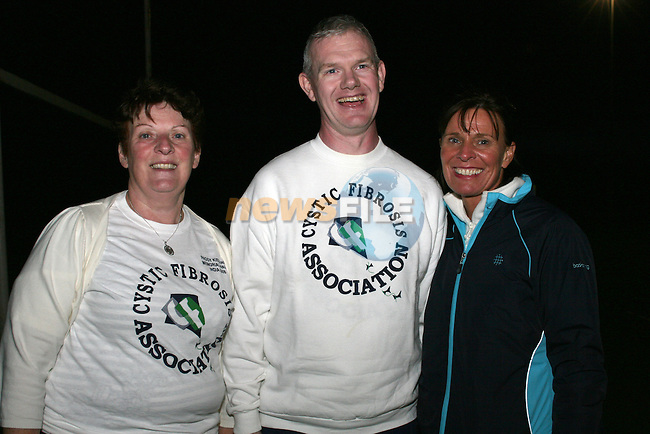 Julia Kierans and Mary Lennon keep Gerard Fay company as he walks around the football pitch for 24 hours in aid of Cystic Fibrosis...Photo NEWSFILE/Jenny Matthews.(Photo credit should read Jenny Matthews/NEWSFILE)....This Picture has been sent you under the condtions enclosed by:.Newsfile Ltd..The Studio,.Millmount Abbey,.Drogheda,.Co Meath..Ireland..Tel: +353(0)41-9871240.Fax: +353(0)41-9871260.GSM: +353(0)86-2500958.email: pictures@newsfile.ie.www.newsfile.ie.FTP: 193.120.102.198.