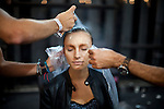 A model gets her hair done backstage for the Brazilian brand, Lino Villaventura, at São Paulo Fashion Week for Summer Season 2013/2014, at Bienal, in Ibirapuera Park, São Paulo, Brazil, on Friday, March 22, 2013.