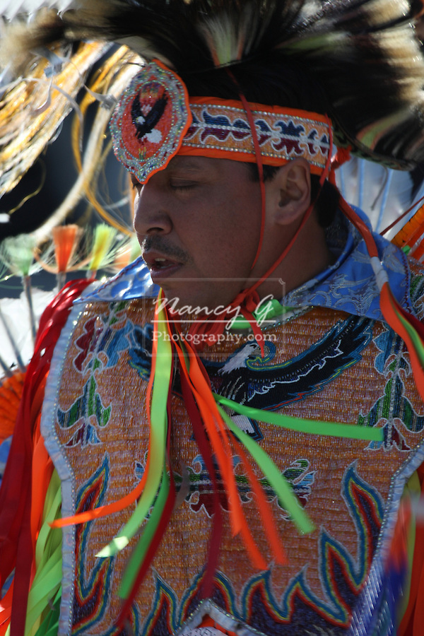 A mature male Native American Menomonee Indian dancer at a Pow Wow at the Milwaukee Lakefront Indian Summer Festival, Wisconsin