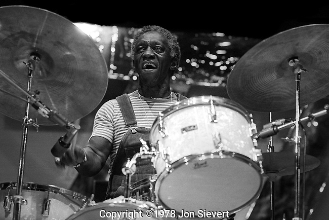 """Art Blakey, 9/18/77, Monterey Jazz Festival. Arthur """"Art"""" Blakey (October 11, 1919 - October 16, 1990),[1] also known as Abdullah Ibn Buhaina, was an American jazz drummer and bandleader.Along with Kenny Clarke and Max Roach, he was one of the inventors of the modern bebop style of drumming. He is known as a powerful musician and a vital groover; his brand of bluesy, funky hard bop was and continues to be profoundly influential on mainstream jazz. For more than 30 years his band the Jazz Messengers included many young musicians who went on to become prominent names in jazz. The band's legacy is thus not only known for the often exceptionally fine music it produced, but as a proving ground for several generations of jazz musicians;  Blakey's groups are matched only by those of Miles Davis in this regard."""