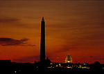 Sunrise in Washington, DC silhouetting the Washington Monument and casting the first light on the Capitol. Undated.