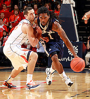 CHARLOTTESVILLE, VA- December 3: Jeremiah Bowman #1 of the Longwood Lancers drives past Sammy Zeglinski #13 of the Virginia Cavaliers during the game on December 27, 2011 at the John Paul Jones Arena in Charlottesville, Virginia. Virginia defeated Longwood 86-53. (Photo by Andrew Shurtleff/Getty Images) *** Local Caption *** Sammy Zeglinski;Jeremiah Bowman