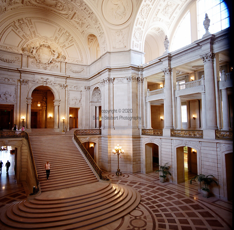 San Francisco's Beaux Arts City Hall Building's interior rotunda with the grand staircase that leads to the Board of Supervisor's meeting chamber.