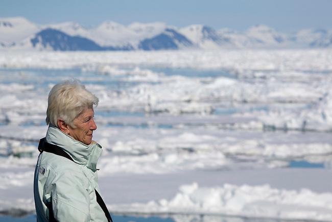 Stylish older woman enjoys an arctic adventure cruise to Spitsbergen
