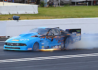Jun 11, 2016; Englishtown, NJ, USA; NHRA pro mod driver Kevin Fiscus has a fire after suffering an explosion during qualifying for the Summernationals at Old Bridge Township Raceway Park. Mandatory Credit: Mark J. Rebilas-USA TODAY Sports