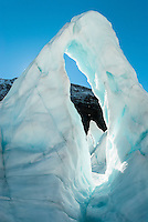 "Beautiful, turquoise icy arch aptly called by glacier guides ""iris"", Franz Josef Glacier, Westland National Park, West Coast, World Heritage Area, New Zealand"